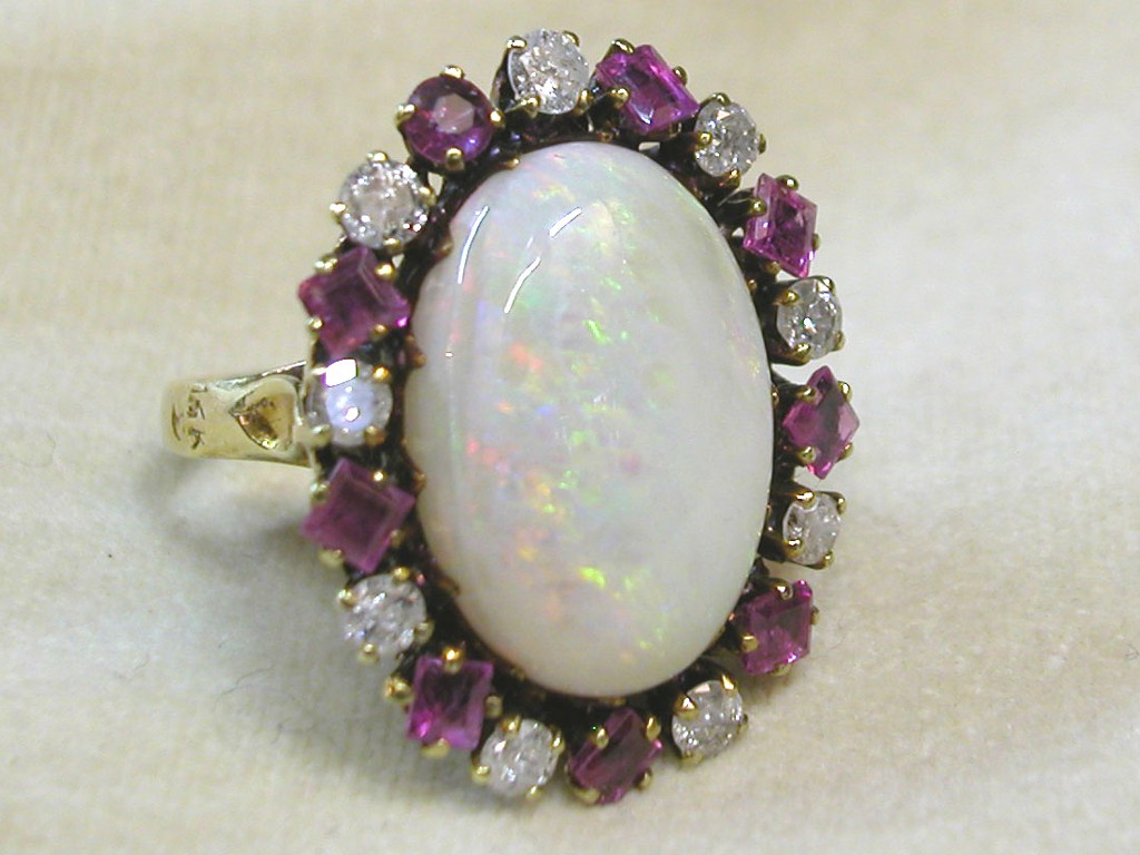 Large Opal Ring with Rubies and Diamonds