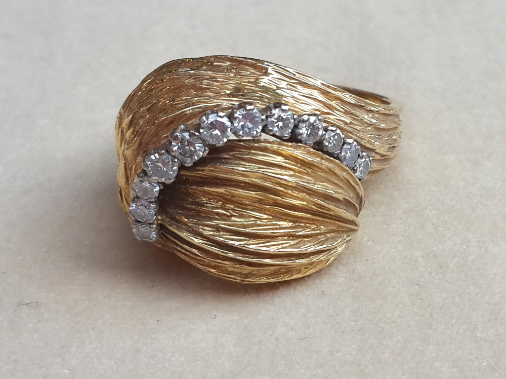 Concave Shaped Gold and Diamonds Ring