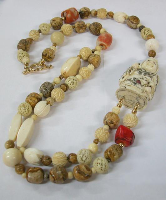 Ivory and Coral Necklace with Woman Shaped Netsuke