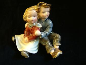 Porcelain Sculpture of a Couple of Children