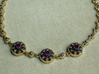 Delicate Gold Bracelet with Rubies