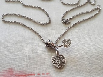 White Gold Necklace - Two Hearts Set with Tiny Diamonds